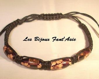 Dark purple wooden flower beads and black macrame bracelet