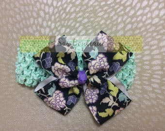 Floral bow with turquoise crocheted band