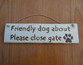Friendly Dog About Sign