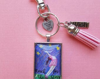 Reach for the Stars Pendant Keychain of wearble inspirational art print from original whimsical drawing of a girl reaching upward.