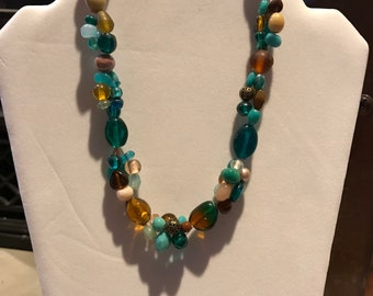 Brown,beige,teal,peach three strand glass beaded necklace