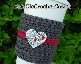 Crochet coffee cup cozy, with a white heart button , made with 100% cotton. Crochet coffee sleeve, crochet coffee cozie