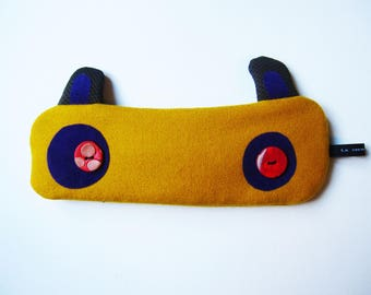 Rabbit in mustard yellow wool bag