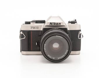 Nikon FM10 35mm film camera with 35-70mm Nikon lens, fitted case and 1 roll film  - great condition - great student camera