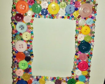 Button mirror