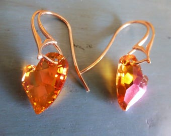 Crystal Hearts Earrings are angled Swarovski Elements hearts in tangerine with pink sparks on sturdy rose gold Vermeil French Eurowires.