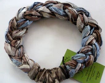 A soft Sari Silk Braided Headband in tones of taupe, bronze, cream and washed denim blue adorns your hair with casual deconstructed charm!
