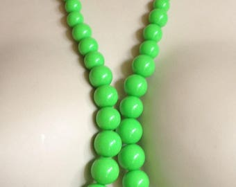Necklace -  round graduated long green plastic necklace