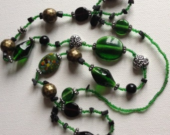 Necklace - pretty emerald green long glass bead necklace