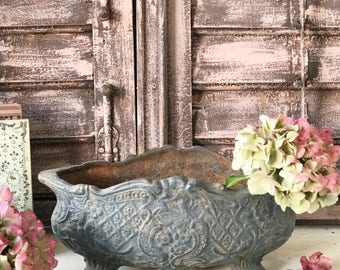 A beautiful cast iron antique French jardiniere