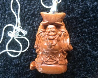 Budda carrying water resin pendant on silver tone chain