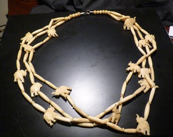 Elephant Charms Necklace --  Handcarved bone -- Three Strands -- Great Condition.