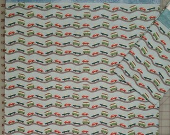 Pillowcase,  Teal, green and red cars on grey roads in a light blue background with trim at opening. Standard size.
