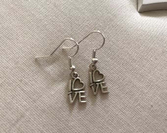 Tiny love heart silver coloured earrings end of line