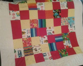 Red and White Lions Roar Quilt with Bernstein Beats and lorax and Dinosaurs Primary Colors Quilt