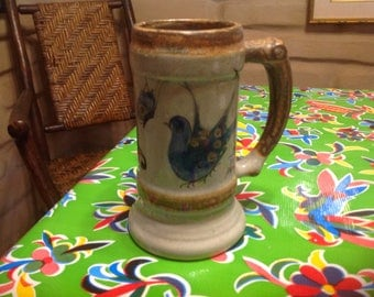 Vintage ceramic Mexican Tonala ceramic hand painted stein with bird, butterfly, and flower designs