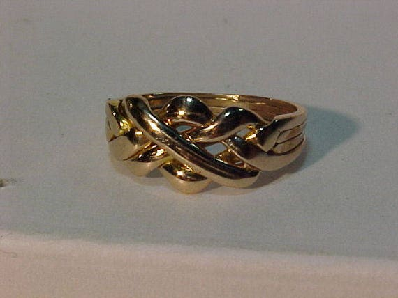 Puzzle ring 4 bandssoldered10k yellow gold professionally