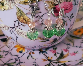 Victorian era style earrings and matching necklace set.  Green and pale pink crystals