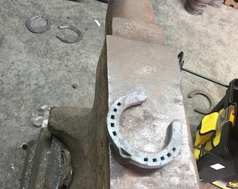 Used horseshoe  includes 2 new horeshoe nails to hang
