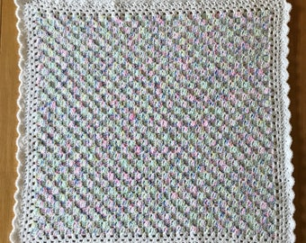 Delicate and pretty crochet baby blanket