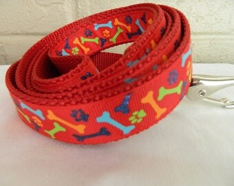 Colorful Bones and Paws on Red Dog Leash
