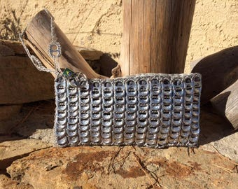 Evening clutch made of recycled cans capsules