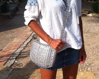 Handbag made of recycled cans capsules