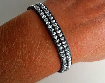 Bracelet woven with aluminum faceted beads. Solid 925 sterling silver end cap clasp. Adjustable size.