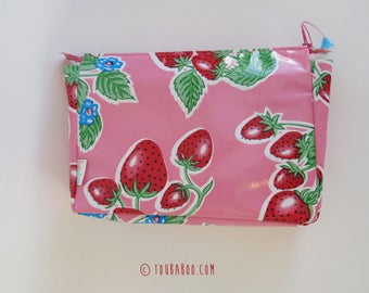 Waxed canvas toiletry strawberries and flowers on pink