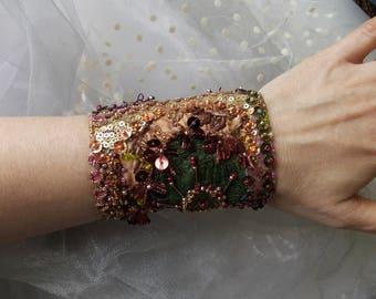Verona... hand beaded collage wrist cuff, manually stitched bohemian fabric cuff bracelet in golden, dark green, burgundy, orange, pink...