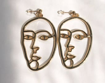 The serious face earrings