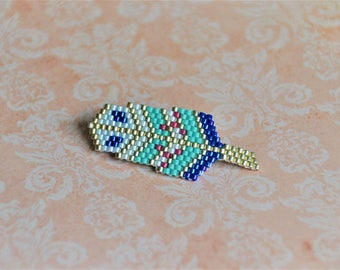 Feather brooch in miuki - blue beads