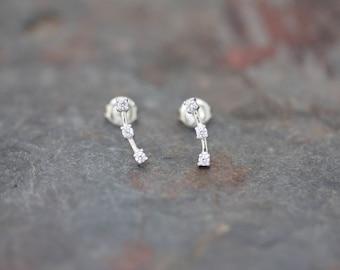 Three stone curved stud earrings