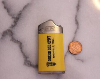 Vintage Grand Ole Opry Lighter Nashville, Tenn Vintage Advertising Yellow Lighter