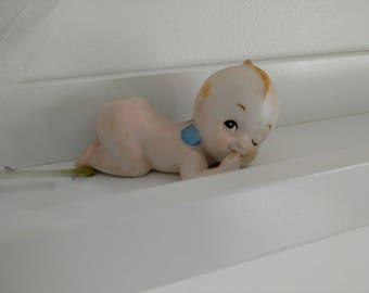 cute kewpie-like mini doll
