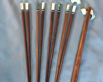 Handmade, Rosewood chopsticks with Green seashell accents and green seashell rests. Set of 5