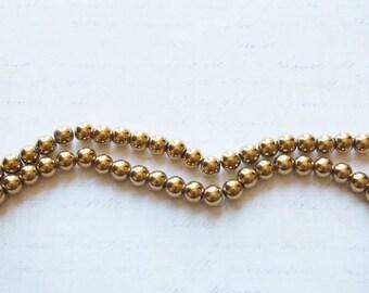 5 Golden hematite 8mm round beads