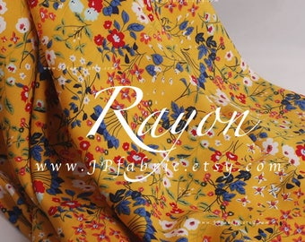 Tana lawn ginger yellow rayon fabric by the yard