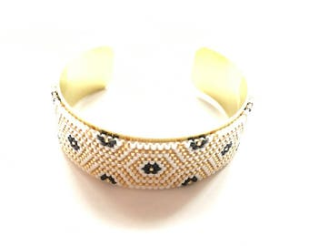 Very nice bracelet black white and gold woven miyuki beads mounted on rigid bracelet