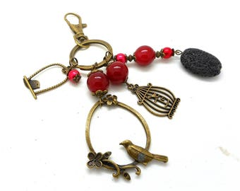 A scent! bag jewel bronze birds and red tones beads