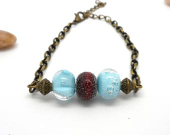 Bracelet bronze beads spun red and blue