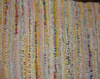Brightly colored handwoven braided rug, 22 x 32