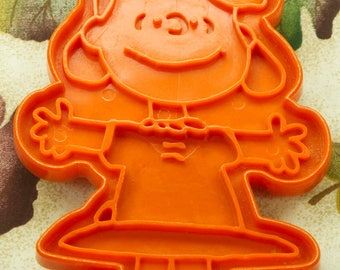 1970's Dk. Orange Plastic Lucy Hallmark Cookie Cutter By United Feature Syndicate, Inc.
