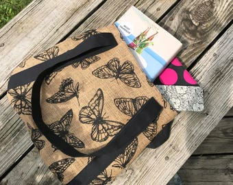 Tote made of burlap, tan with black butterflies, interfaced and fully lined.