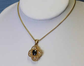 Vintage Necklace Pendant Gold Tone Rope Loops Black Faceted Centre Stone and Four Miniature Ice Rhinestones at all points Lovely Box Chain