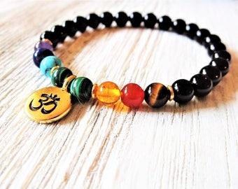 Om bracelet with 7 Chakra stones / Healing energy mala bracelet with black onyx / Chakra balance stretch bracelet / Gold Om charm & accents