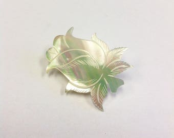 Carved, mother of pearl, rose bud brooch.