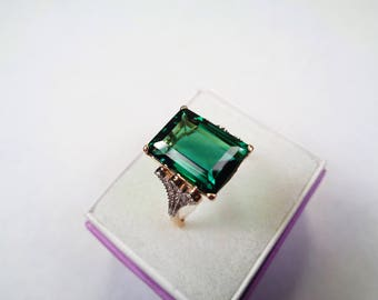 Blue Green Topaz Ring. 8.ct.,14 x 10 mm. Topaz in a 10kt. Gold Ring with Diamond Accents.