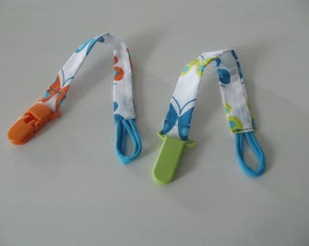 fabric pacifier clip has plastic clip, orange or green cord