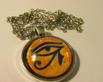 Silver Tone Glass Dome Pendant of Egyptian Eye of Horus , 1""